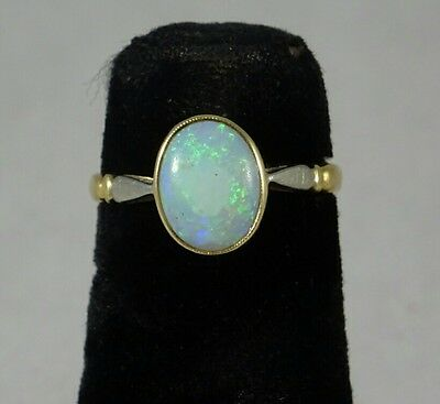 French Edwardian 9 Ct Gold Cabouchon Oval Opal Ring size I, marked with Eagle