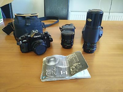 Canon A1 35mm film camera with extra lenses. Recently serviced. No Canon Cough.