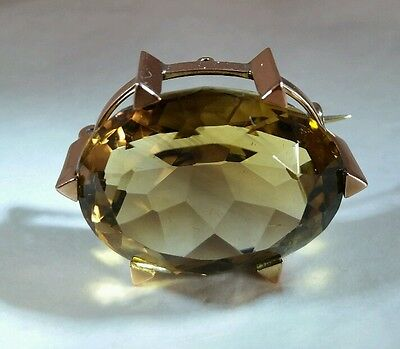 An Edwardian 9ct yellow brooch. Claw set with a facet cut oval Citrine Gemstone