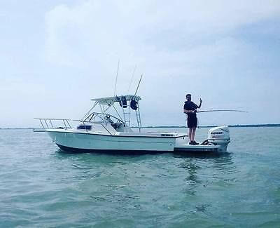 24ft SPORTS FISHING AND WAKEBOARDING CUDDY BOAT AND TRAILER VERY FAST