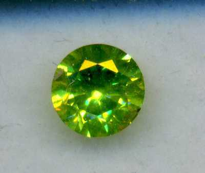 "Russian natural Urals demantoid.0.35ct with a ""ponytail""lowered pricе"