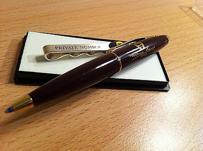 2 Promotionartikel 'Etienne Aigner Parfums' Ball Point Pen + Krawattenspange