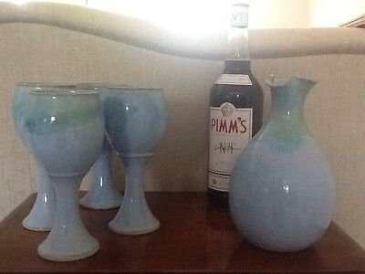 Hand thrown pottery carafe and 4 goblets