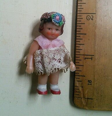 Vintage dolls house rubber 1950's girl dressed doll 1/16th scale