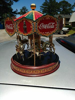 Coco cola Carousel... Collector. Excellent condition. Perfect for any collector.