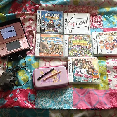 Pink Nintendo Ds lite console , charger, 2 cases and 6 games