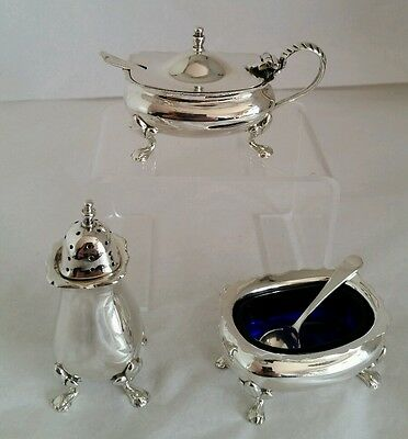 George VI three piece sterling silver cruet set. Birmingham 1942. By Gieves Ltd