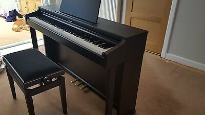 Roland hp 201 piano and stool