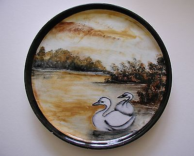 small hand painted decorative plate, landscape, water, swans, brown-gold tones