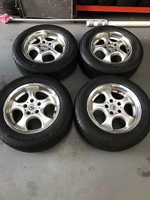 4 X Ford Falcon Ef/el Mag Wheels And Excellent 215/60/r16 Tyres