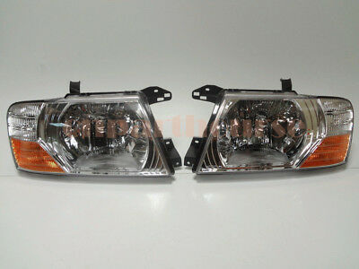 Mitsubishi Pajero Montero Left and Right Set front head lamps lights 2000-2006