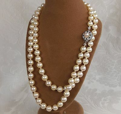 Japanese 7mm uniform saltwater Pearl Opera necklace 14ct gold sapphire clasp