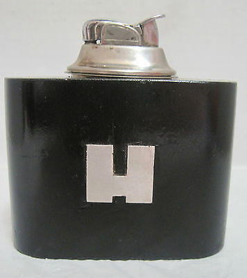 Big silver H lighter with Evans insert.