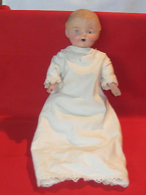 Antique 1914 bottle tot bisque head doll, open mouth, jointed cloth body