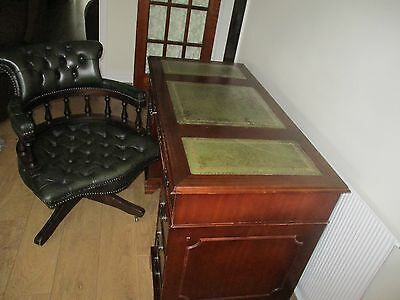 Leather top  Captains Desk with locks/Key & matching Mahogany Captains Chair .