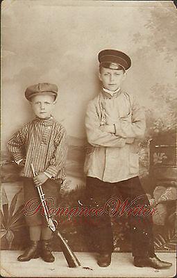 Young Boys Hats a Rifle Boots Antique Photograph dated 1911 on back RPPC