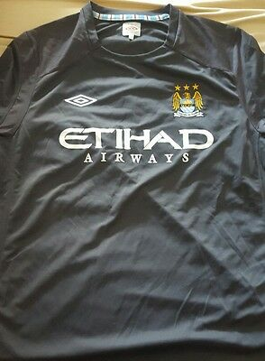 Maillot MANCHESTER CITY taille XL  UMBRO