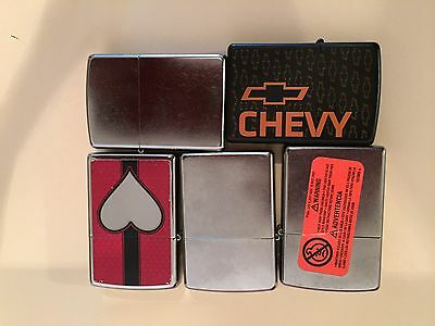 Set of five 5 Zippo Lighter chevy , heart , silver Gift collection used and new