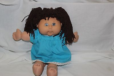 2004 Cabbage Patch doll, brown crimped pigtails, hazel eyes.