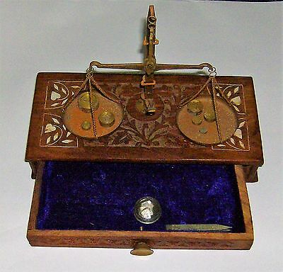 Carved Wooden Box With Brass Balance Scales And Weights.