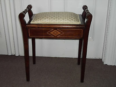 Antique Piano stool, mahogany with inlay banding and underseat storage.