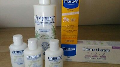Lot MUSTELA Vacances Solaire + Liniment + Cr change + couches little swimmers