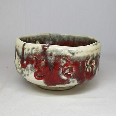 A154: Japanese pottery tea bowl of good style of glaze and red tone