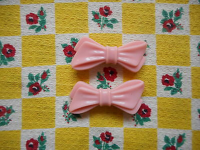 Two pretty vintage fashion 50's kitsch plastic novelty bow hair clips/slides