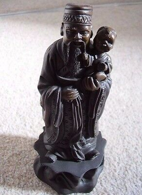 Japanese Okimono figure of a man holding a child figure- ornament,signed