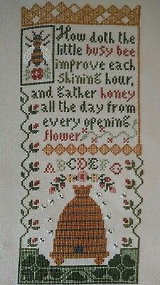 finished cross stitch bee sampler