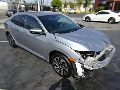2017 Honda Civic LX Hatchback 2017 Honda Civic LX Hatchback Salvage Wrecked Repairable! New Body! 902 Miles!
