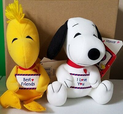 plush Snoopy and Woodstock dolls
