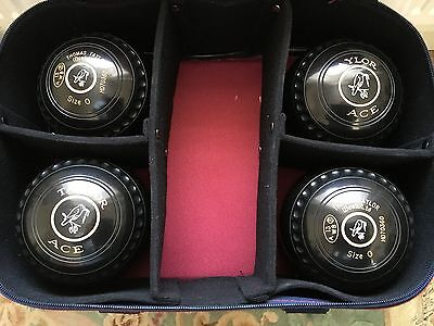 4 Thomas Taylor Ace lawn bowls size 0 and Welkin bowls bag.
