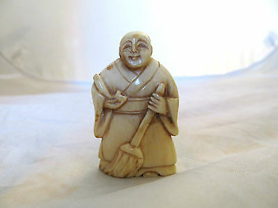collectible old japanese carved netsuke, a man with brush,  unsigned .