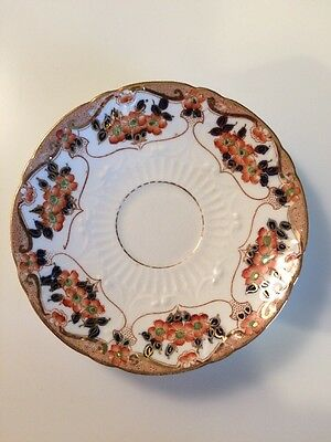 Vintage Sutherland Saucer, orange and black floral design