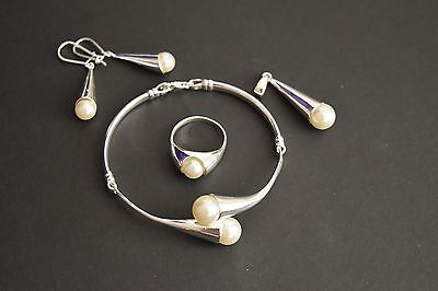 925 Sterling Silver Pearl Stone Ring, Bracelet, Earrings and Pendant Set.