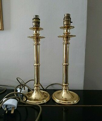 a pair of vintage brass table lamps