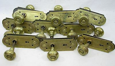 Set of 9 Matching Antique Brass Door Knobs & Back Plates