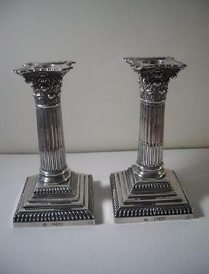 A Pair of Antique Silver Corinthian Column Candlesticks: London 1895
