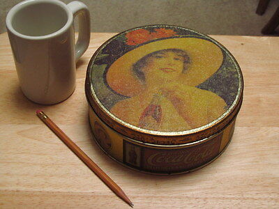 "Coca Cola tin  7"" wide Woman with hat"