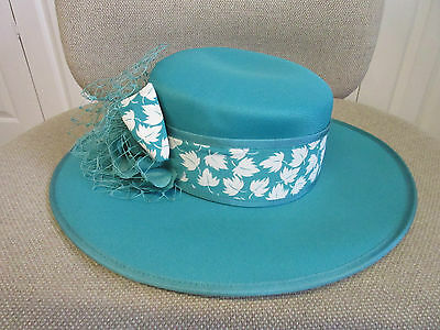 Eastex dark turquoise hat with floral decoration