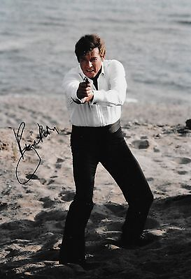 roger moore with his gun JAMES BOND signed 12x8 photo PROOF