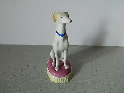Staffordshire Greyhound or Whippet Dog Bisque Figurine on red base