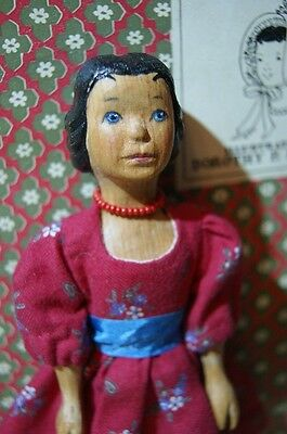 Beautiful carved wood Hitty doll in vintage style.