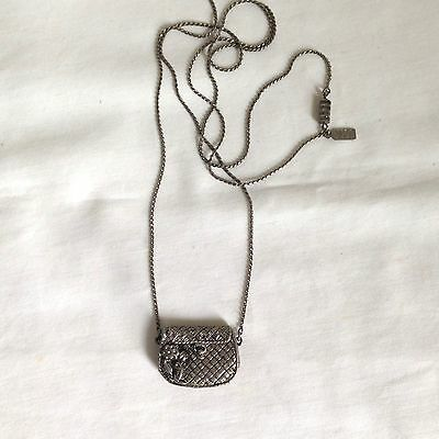 Vintage 1928 Long Silver Tone Necklace with Handbag Pendant that opens