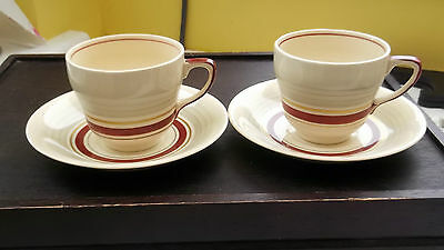 Two Pre 1961 Grays Pottery Cups And Saucers  Red Band Grey Top