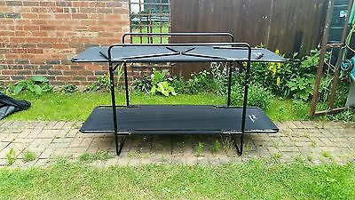 black camping bunk beds can be used singular Quest Traveller with storage bag