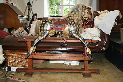 Antique Collinson rocking horse in original condition.