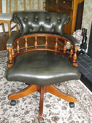 Used green leather and wood Captains chair
