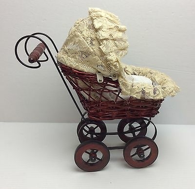 Vintage Wicker Pram Stroller Carriage with Antique Porcelain Baby Doll